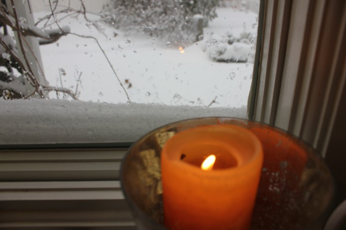 candles in a snowy window