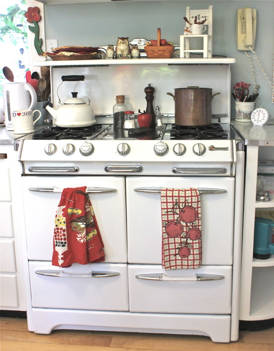 love the dishtowel display unit