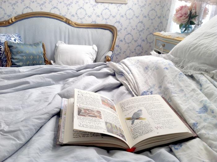 https://www.susanbranch.com/wp-content/uploads/2015/09/reading-on-bed-1-700x523.jpg